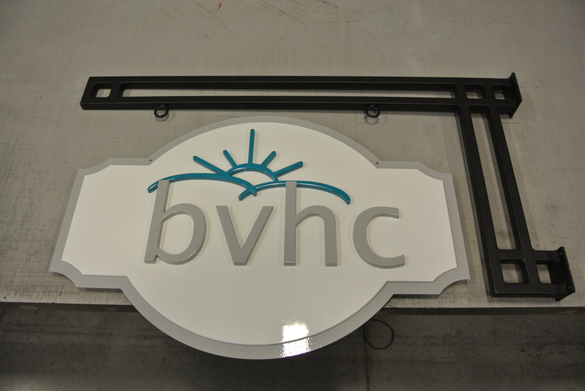 Routed aluminum / PVC sign.